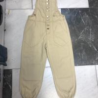 杏色背带裤