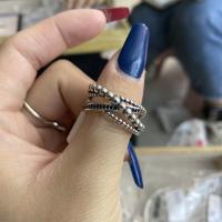 交叉加黑钻戒指