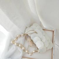 珍珠圆片手提包